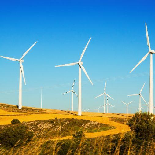 Wind farm at farmland in summer. Aragon